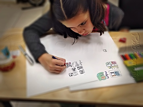 Mexican girl learning ancient Maya writing. Copyright 2015 Miguel Omaña.